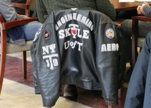 A Skule jacket rests on a chair.