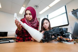 Students pose with robotics.