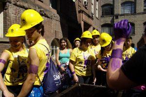 Students wearing hard hats and purple dye