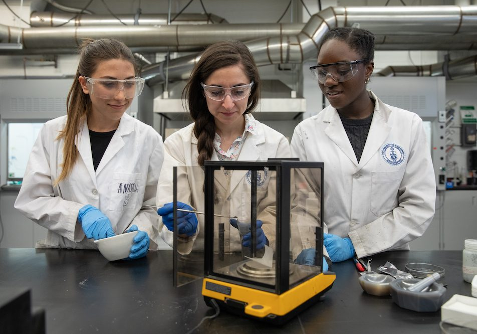 (From left to right)  Anastasia Alksnis, MASc Candidate, Alexandra Tavasoli, PhD Candidate, and Ayesha David, MASc Candidate work in the MSE Lab at the Wallberg Memorial Building at the University of Toronto in Toronto, Ontario on May 9, 2018. Photo by Laura Pedersen/Engineering Strategic Communications